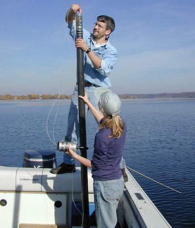Mark Edlund and Laura Triplett boat a sediment core on Lake St. Croix.