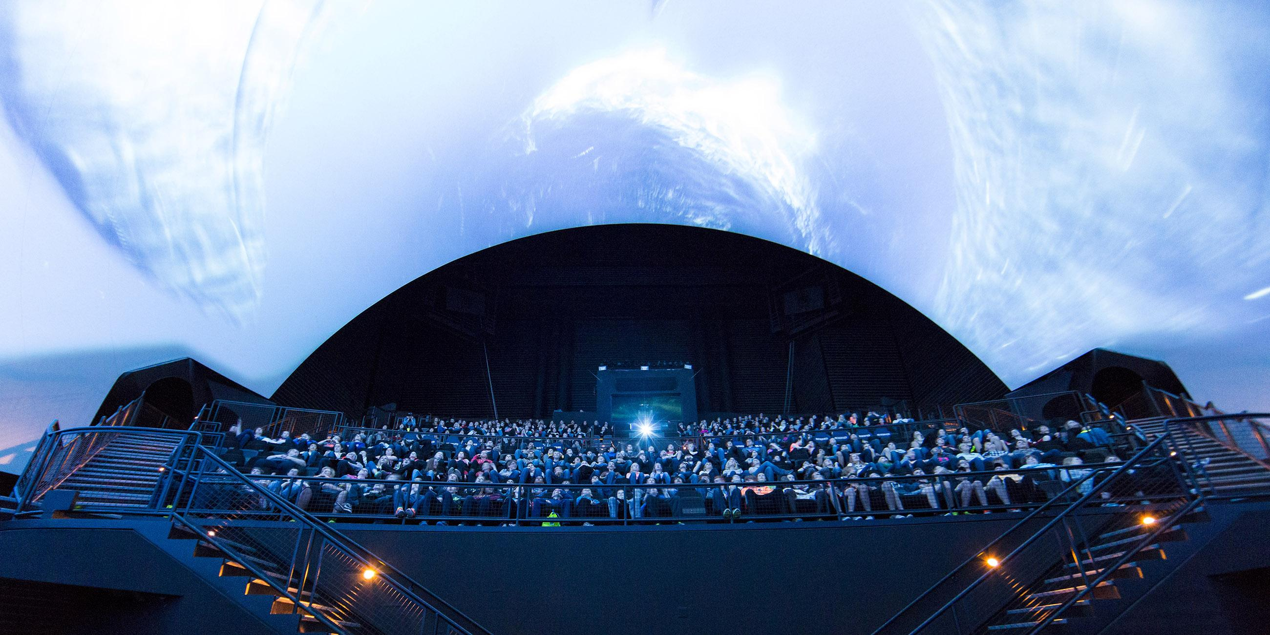 Photo of Omnitheater audience watching a film.