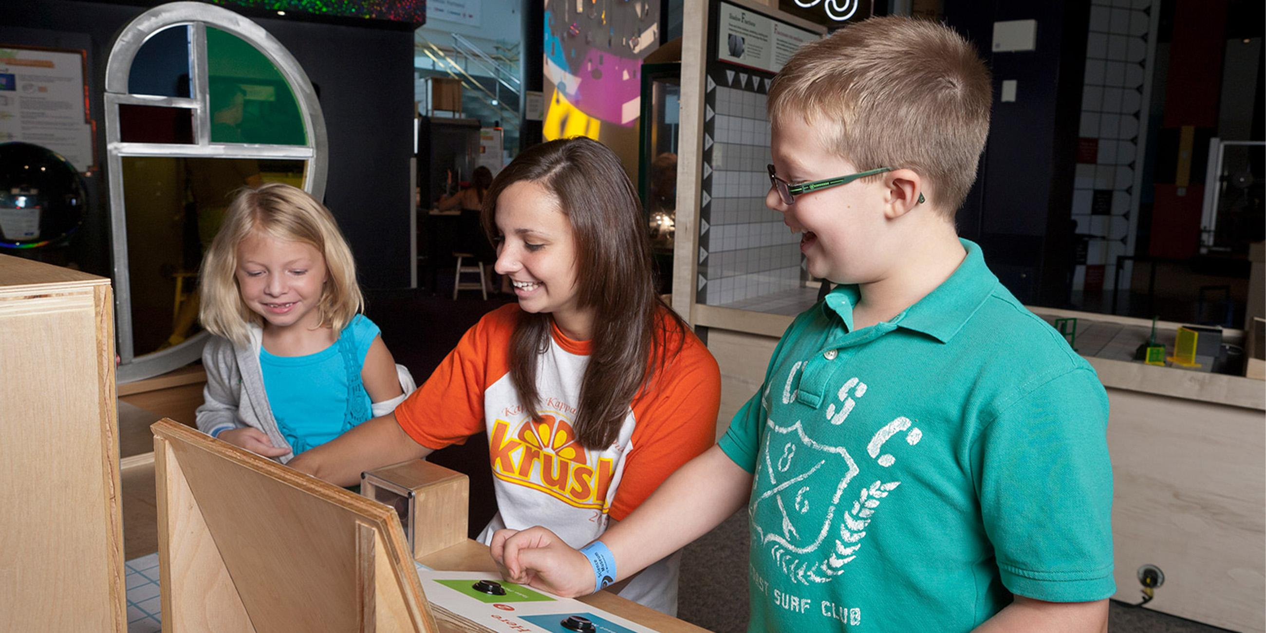 Kids experimenting in the Math Moves gallery.