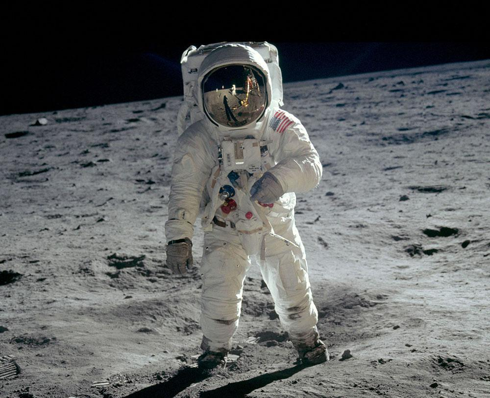Photo of Buzz Aldrin standing in a space suit on the surface of the moon.