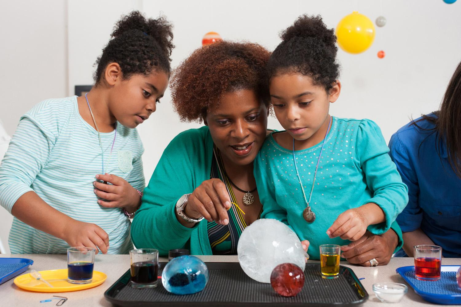 A Family Making Discoveries Through An Experiment