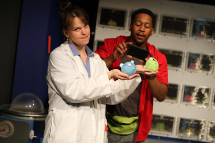 Image of two actors handling the Vista monsters in the Infestation show.