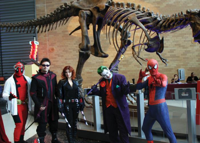 A group of Spooky Science attendees, dressed in costume in the museum lobby.