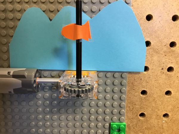 Fish spinning on a Lego axel controlled by a Lego motor