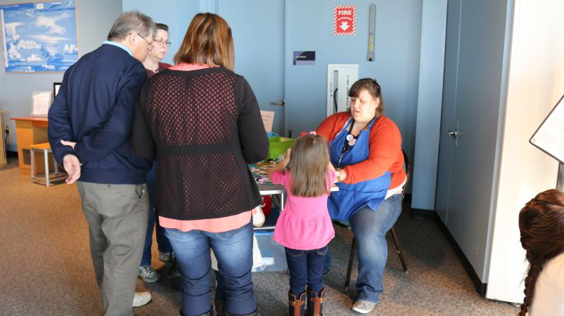 Visitors making buttons with images of diatomaceous earth.