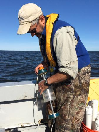 Mark prepares to collect a nutrient sample from the bottom waters .