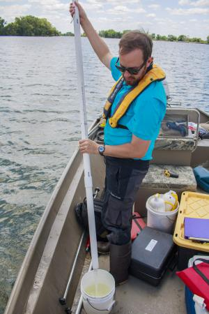 Adam Heathcote taking a 2-meter integrated water sample from the top of St. James Lake (June 2016)
