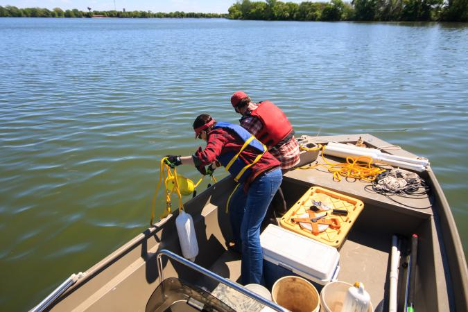 Installing sensor buoy in St. James Lake (May 2016)