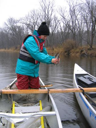 Joy Ramstack Hobbs sampling the St. Croix River